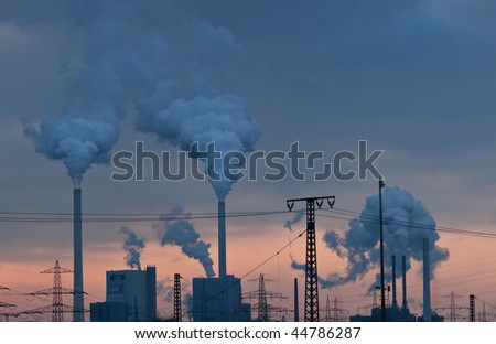 Power Plant at Dusk against red sky