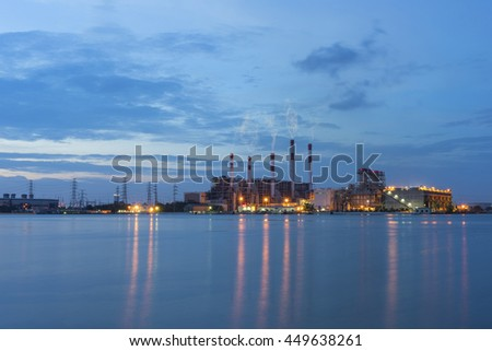 Power plant at dusk with water reflextion , industrial landscape