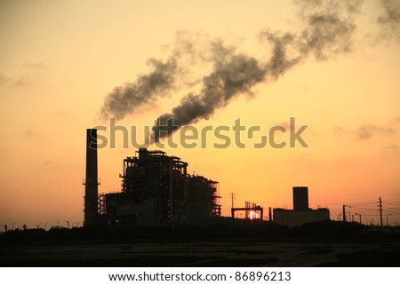 Power plant at sunset - stock photo