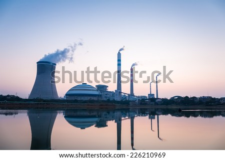 power plant at twilight and the reflection of the lake