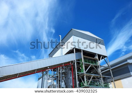 Power plant building with blue cloud sky background. - stock photo