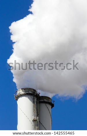 Power plant chimney emission - stock photo