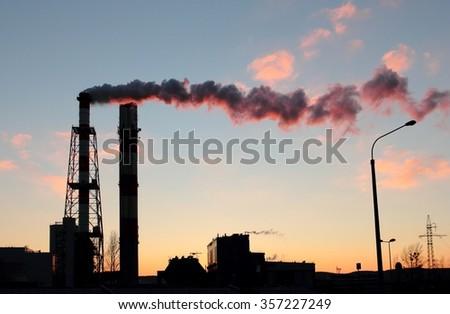 Power plant chimneys at the dusk, Gdynia, Poland - stock photo