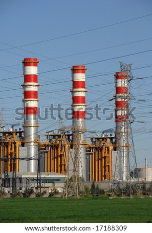 Power plant chimneys, cooling towers emitting steam - stock photo