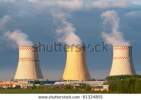 Power plant cooling towers against blue sky - stock photo