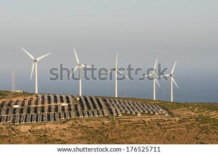 Power Plant Renewable Energy Wind Turbines and Solar Panels - stock photo
