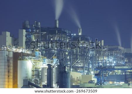 Power plant smoke at night - stock photo