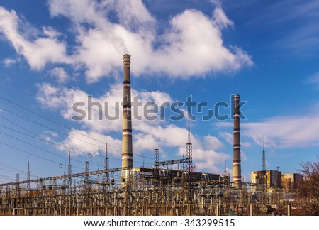 Power plant - transformation station. Multitude of cables and wires, transformers. - stock photo