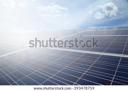 Power plant using renewable solar energy on blue sky cloud with ray background.  - stock photo