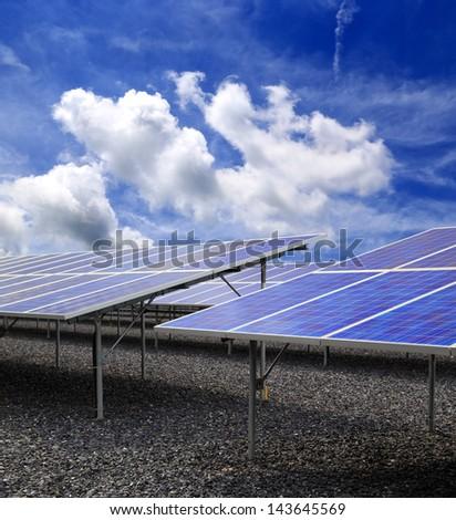 Power plant using renewable solar energy with blue sky - stock photo