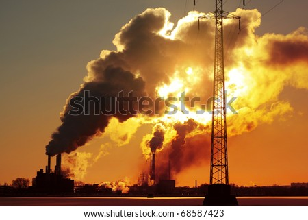 Power plant with huge smoke and electric towers - stock photo