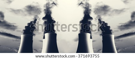 Power plant with several chimneys and huge fumes