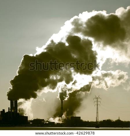 Power plant with smoke - stock photo