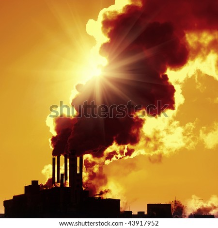 Power plant with smoke - stock photo