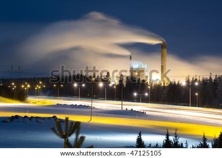 power plant with smoke at night - stock photo