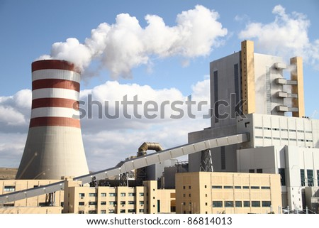 Power plant with smoking chimney - stock photo