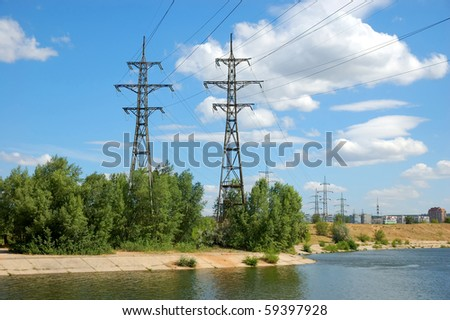 power plant with two towers on river bank - stock photo