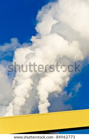 Power plants generating smokes at sunrise in Powell River, British Columbia, Canada. - stock photo