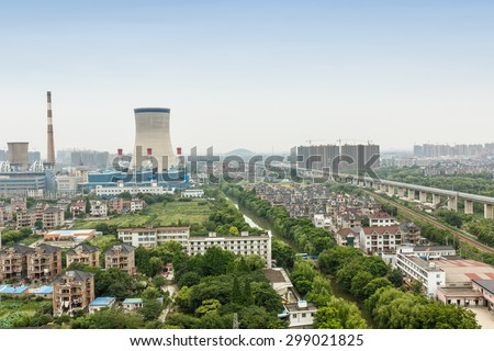 Power plants in residential areas aerial view - stock photo
