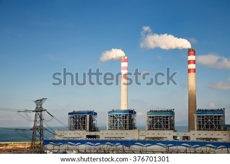 Power plants in the blue sky white cloud background