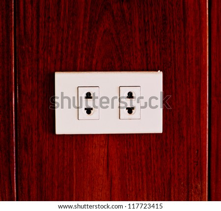power plug on wood backgrounds - stock photo