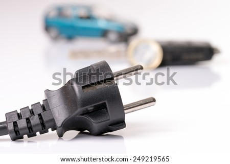 Power plug with euro money and car key / electric car