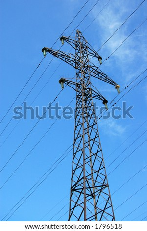 Power pole and cables on cloudy sky - stock photo