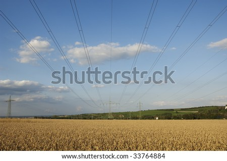power pole in front of blue sky and clouds