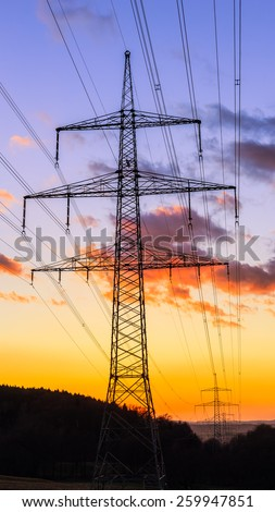 Power Pole Romance. Electricity Pylons in the Setting Sun. Silhouette Picture