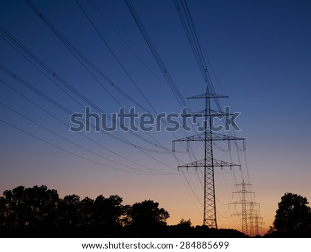Power poles at dusk on a clear summer evening
