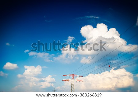 Power Poles on blue clouds background - stock photo