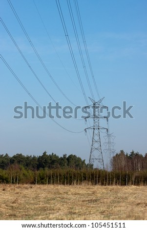 power pylons and wires during sunny day