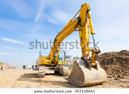 Power showel in a construction site - stock photo