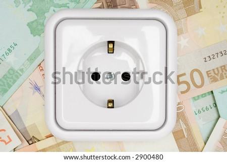 Power Socket on Banknotes - stock photo