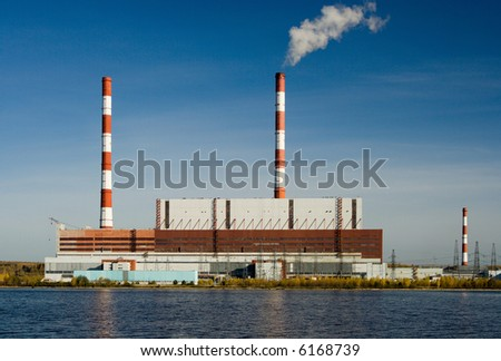 Power station. A kind from the river. - stock photo