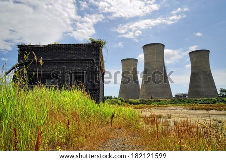 Power Station - Abandoned power station reclaimed by nature - Cooling towers - UK - stock photo