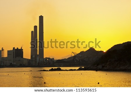 Power station along coast at sunset in Hong Kong - stock photo