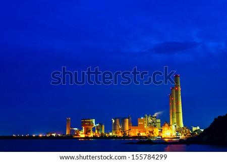 power station at night, hong kong - stock photo