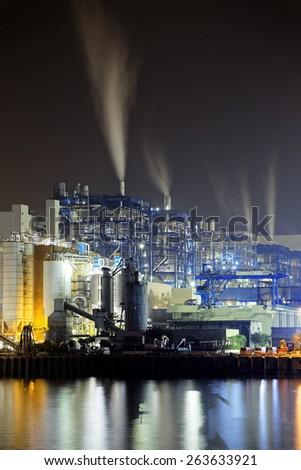 power station at night with smoke, hong kong - stock photo