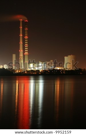 power station by night - stock photo