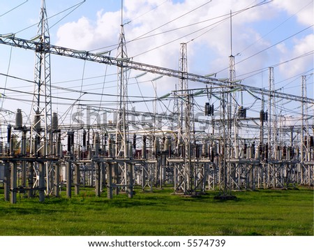 power station equipment under cloudy blue sky - stock photo