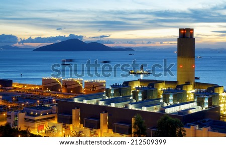 power station petrochemical industry on sunset. - stock photo
