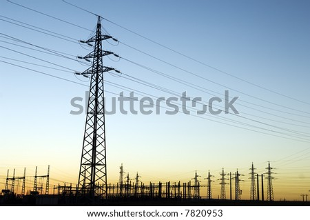 Power substation and pylon with distribution lines at sunset. - stock photo
