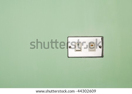 Power switch on/off on green wall - stock photo