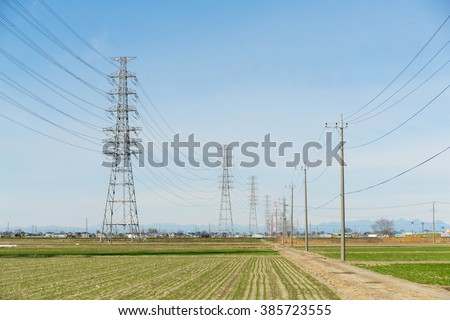 Power Tower with blue sky - stock photo