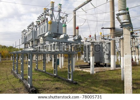 Power transformer in a distribution substation separated from another one by a wall. - stock photo
