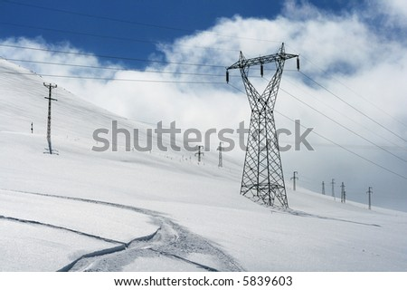 power transmission line at mountains - stock photo