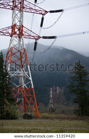 Power transmission lines and towers disappearing into the clouds