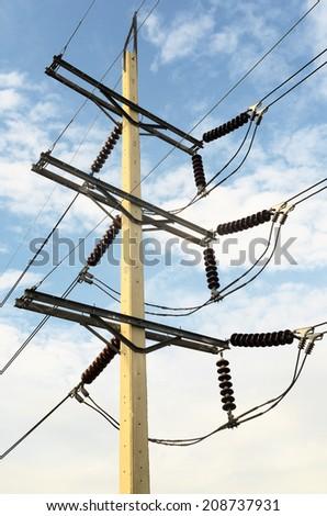Power transmission lines (115 kV System) against blue sky / Power transmission lines   - stock photo