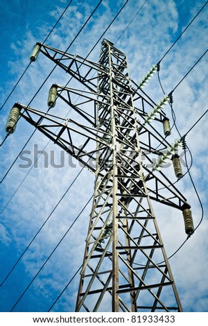 Power transmission tower against the blue sky background - stock photo